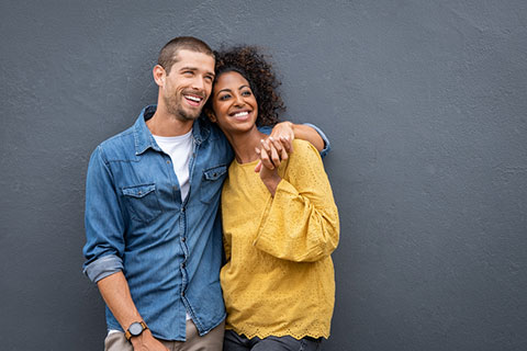 Happy couple - man with arm around woman